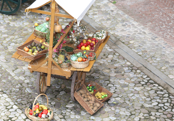cart with fruits and vegetables for sale in the country's fruit and vegetable market